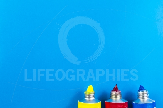 Paint colors on blue background