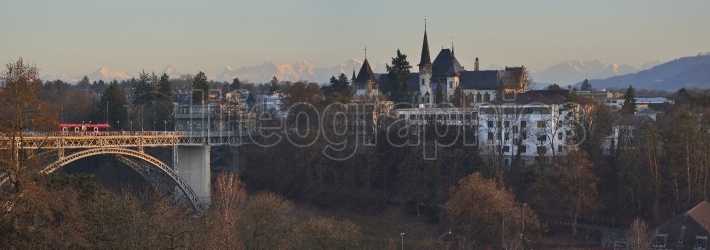 Panoramic view of Kirchenfeldbrucke Bridge and castle in Bern at sunset