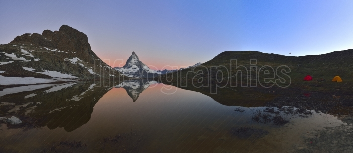 Panoramic view of the Matterhorn 4478m and Dente Blanche 4357m reflected in the Riffelsee