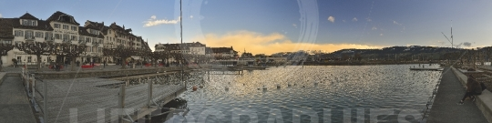 Panoramic view on sunset over the Lake Zurich in Rapperswil city.