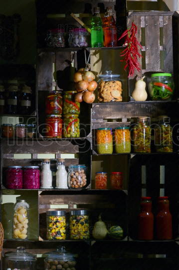 Pantry with Jars And Pickled Vegetables