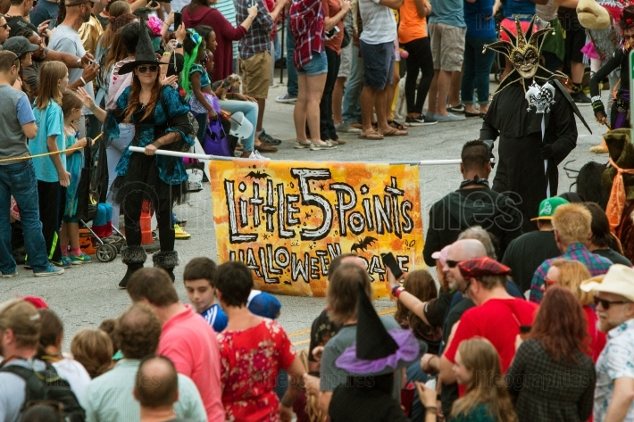 People Carry Banner To Start Little Five Points Halloween Parade