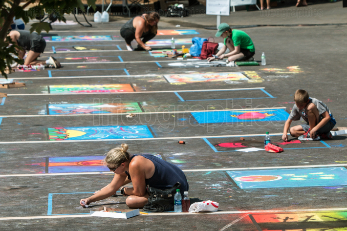 People Draw Chalk Art On Parking Lot Pavement In Competition