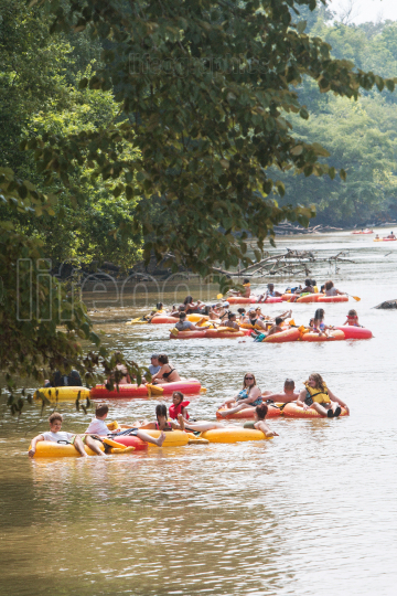People Tube Down The Chattahoochee River On Hot Summer Day