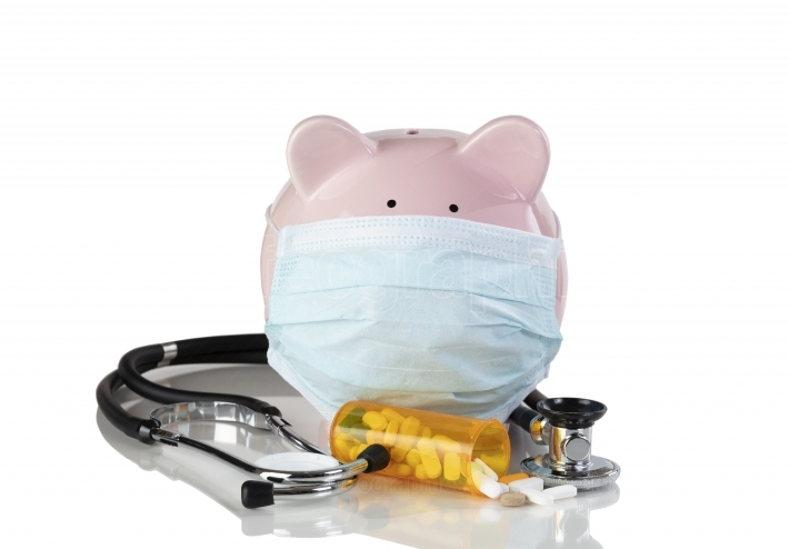 Piggy bank wearing surgical mask with medical drug supplies isol