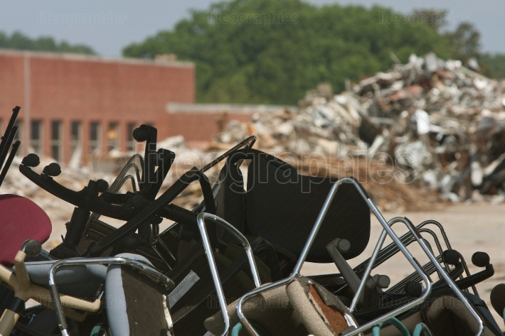 Piles Of Discarded Office Chairs And Debris At Demolition Site
