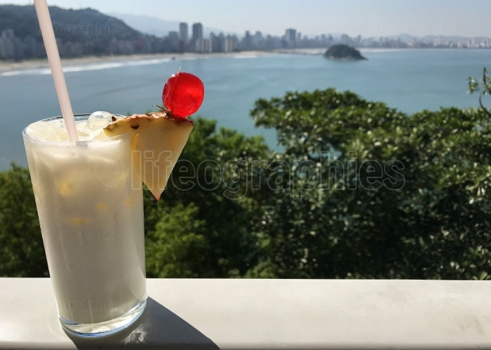 Pina Colada Drink Sits On Ledge Overlooking Spectacular Brazilia