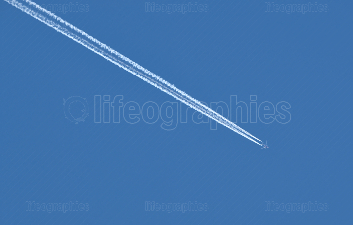Plane traces on the blue sky