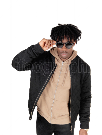 Portrait image of a black man in jacket with sunglasses