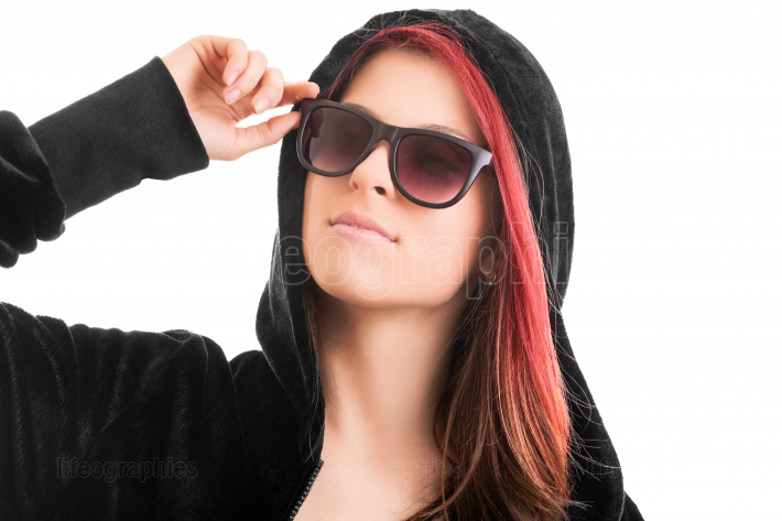 Portrait of a beautiful stylish girl with hoodie and sunglasses