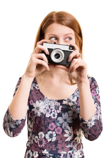 Portrait of a beautiful young girl holding a camera