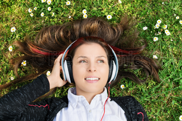 Portrait of a beautiful young girl with headphones