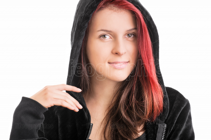 Portrait of a young girl in a hooded sweatshirt