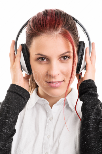 Portrait of a young girl with headphones on