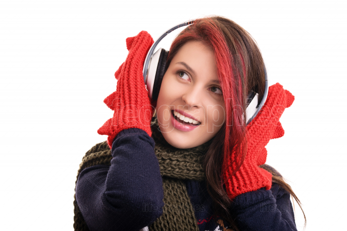 Portrait of a young girl with winter clothes and headphones