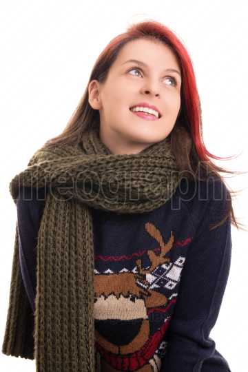 Portrait of a young happy girl in winter clothes