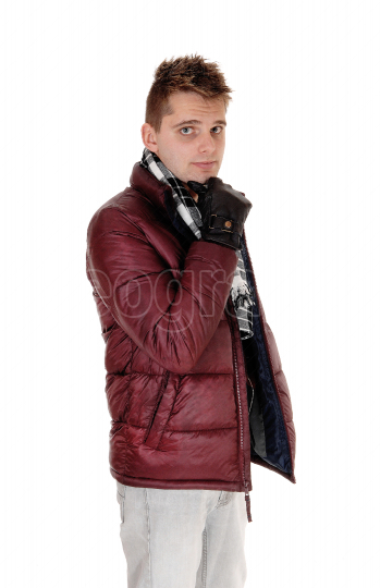 Portrait of a young man in a burgundy winter jacket