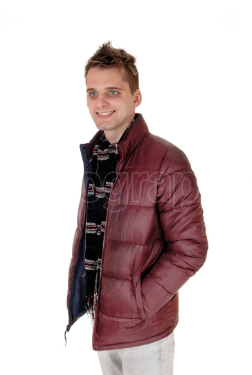 Portrait of a young smiling man in burgundy jacket