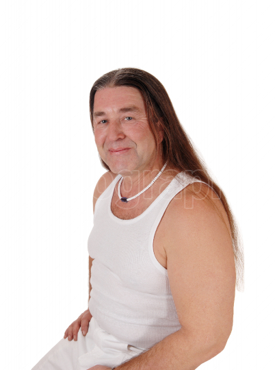 Portrait of an indigenous man with long hair in under shirt