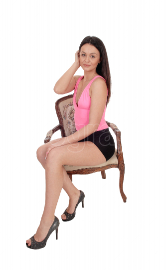Portrait of beautiful woman sitting in a chair