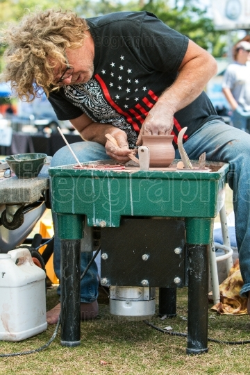 Pottery Artist Forms Clay Bowl With Hands At Arts Festival