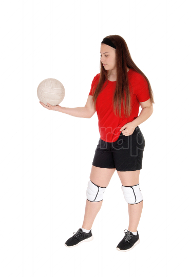 Pretty teenage girl playing her volley ball
