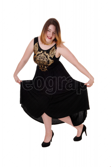 Pretty woman dancing in a long dress