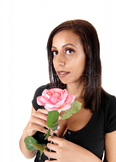 Pretty woman holding a pink rose