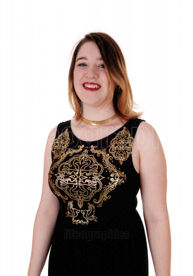 Pretty woman standing in a black dress with gold ornaments