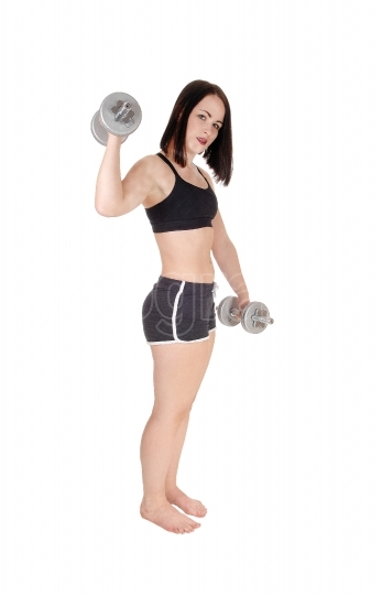 Pretty woman working put whit two dumbbells