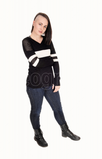 Pretty young woman standing in jeans and sweater