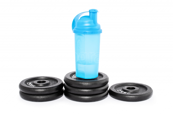 Protein shaker on a pedestal of weight plates