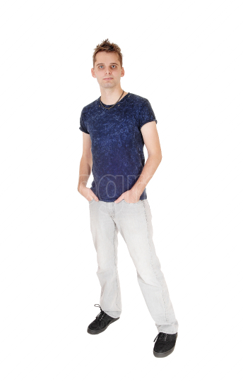 Puzzled young man standing with hand in his pocket