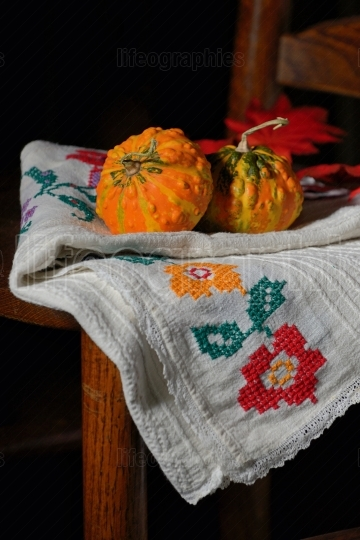 Raw pumpkins on rustic chair
