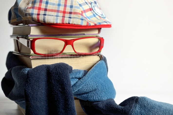 Reading glasses with books and neckerchief
