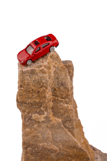 Red car on the top of a rock