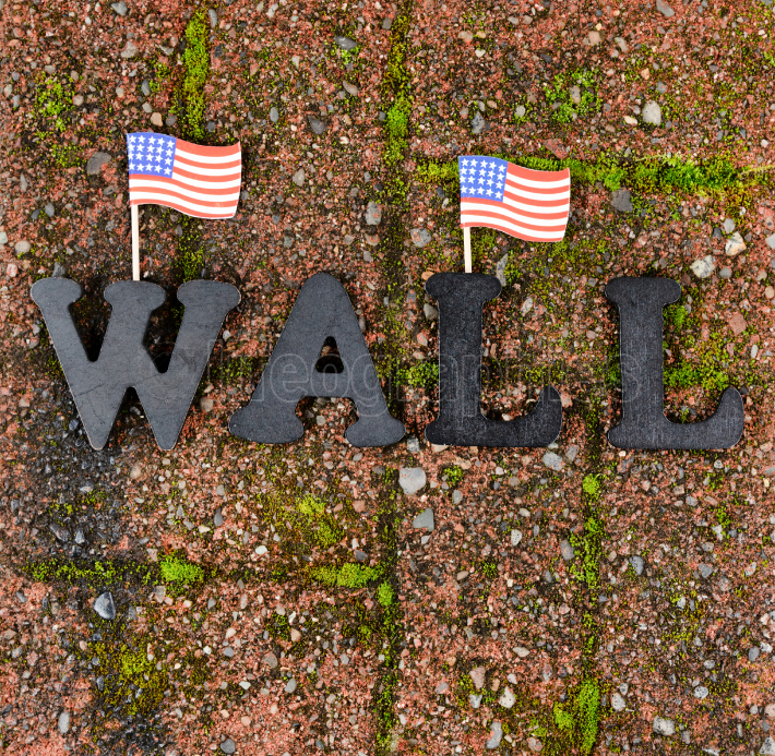 Red grunge brick with metal letters and United States flags for