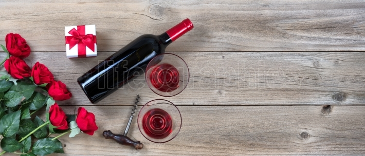 Red Wine for Valentines Date on rustic wooden background
