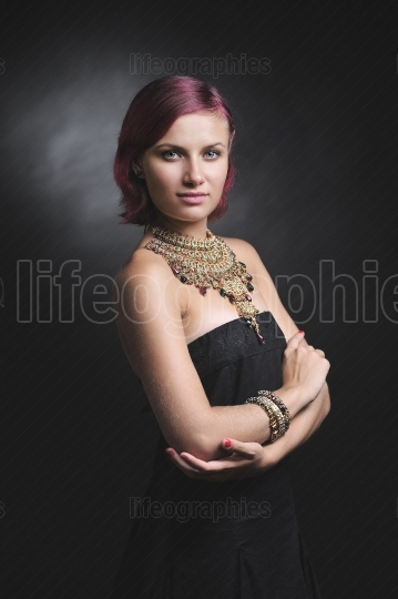 Rich retro diva. Fashion model with red hair