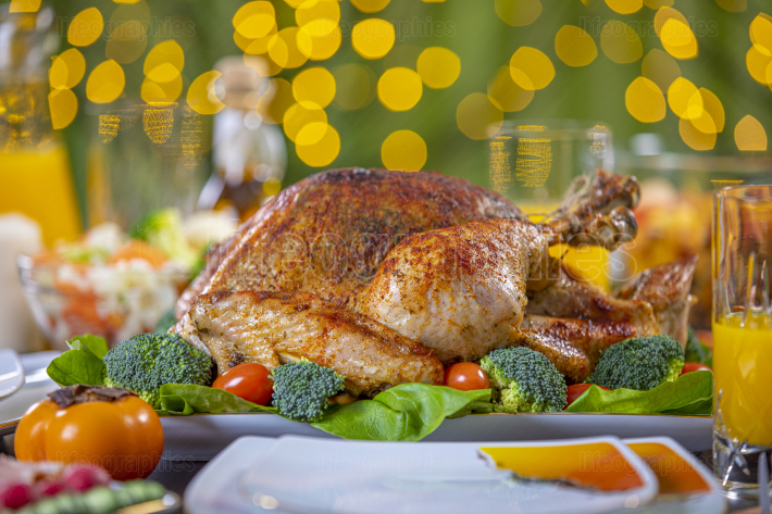 Roasted turkey on festive table for Thanksgiving celebration