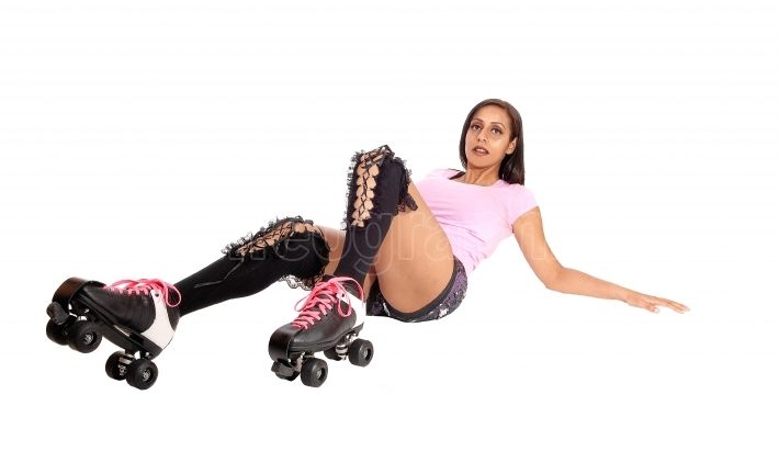Roller skating woman lying on floor