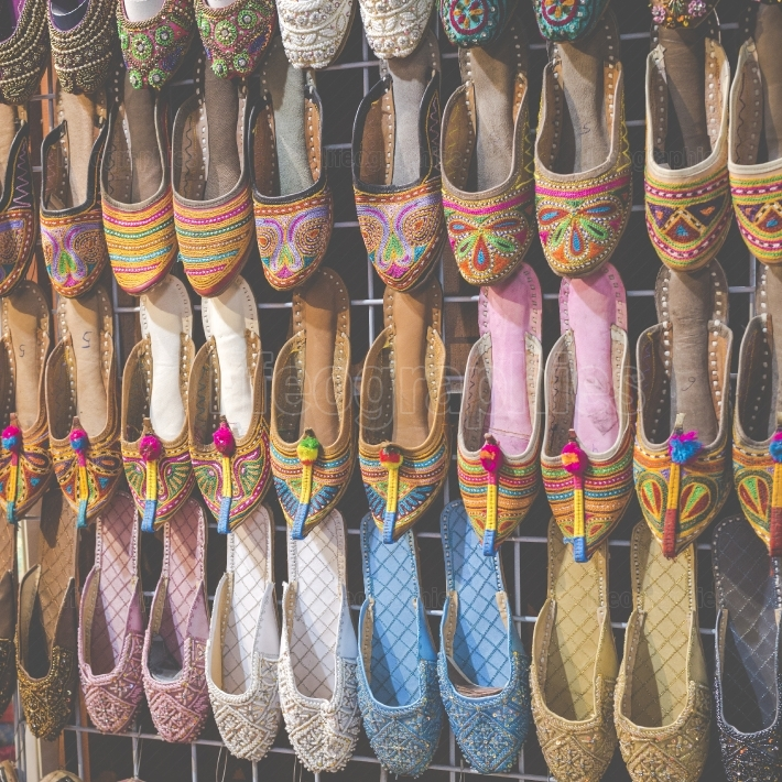 Rows of typically oriental shoes at the market in Dubai