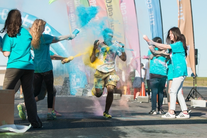 Runner Gets Squirted With Multiple Colors At Color Run