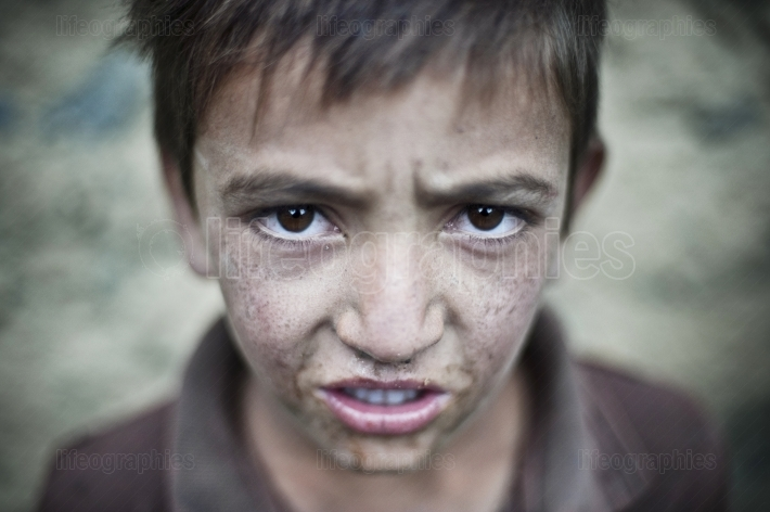 Sad face of a young boy from Shimshal village.