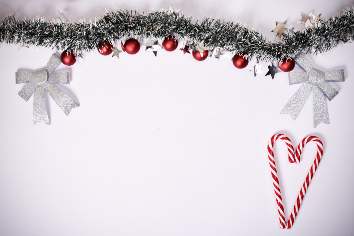 Seasonal composition with garland and candy cane heart