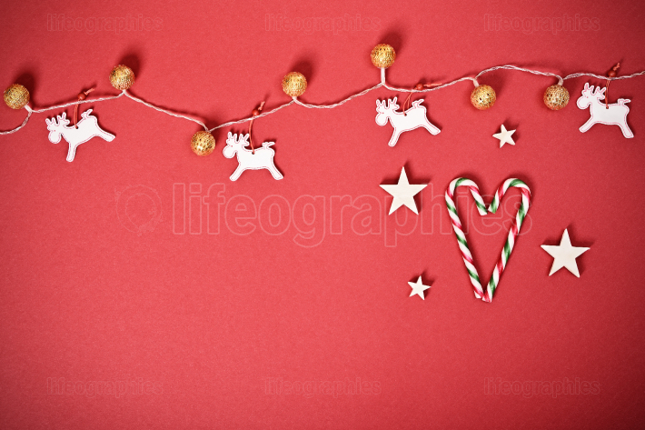 Seasonal greeting card concept with Christmas lights and candy c