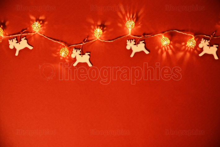 Seasonal greeting card concept with Christmas lights and reindee
