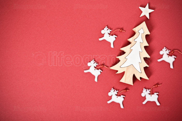 Seasonal greeting card concept with Christmas tree and raindeers