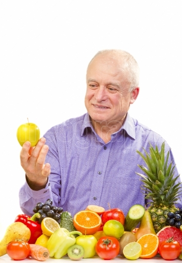 Senior man holding apple