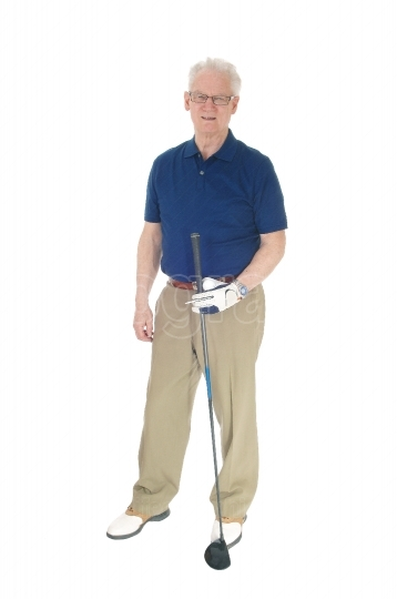 Senior man standing with golf iron